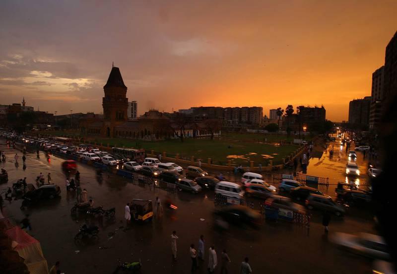 epa08552624 View of the orange-tinged sky at sunset following heavy monsoon rains in Karachi, Pakistan, 17 July 2020.  EPA/SHAHZAIB AKBER