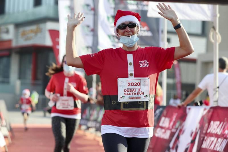 Dubai, United Arab Emirates - December 11, 2020: People take part in the Santa fun run at Dubai festival city. Friday, December 11th, 2020 in Dubai. Chris Whiteoak / The National