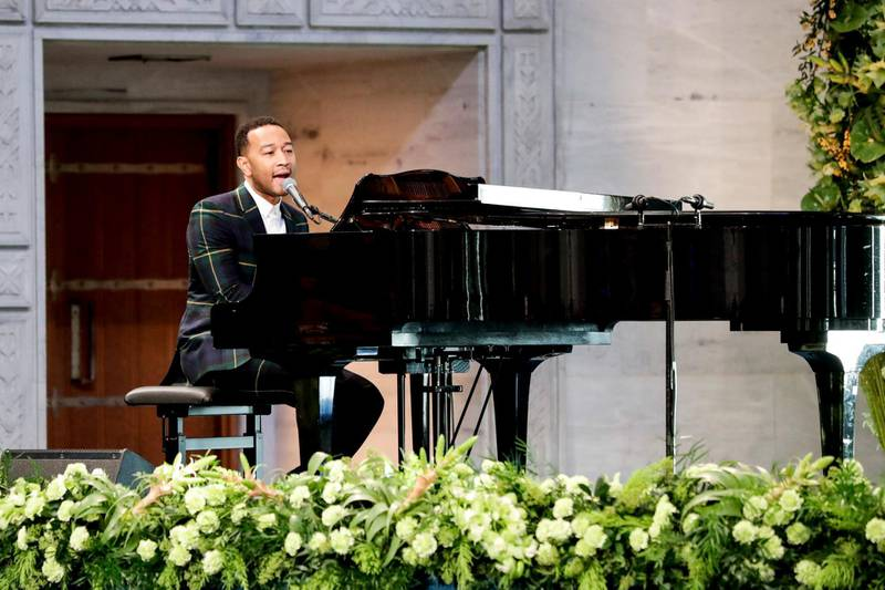 """US musician John Legend plays the piano during the award ceremony of the 2017 Nobel Peace Prize at the city hall in Oslo, Norway, on December 10, 2017. The Nobel Peace Prize was awarded to the International Campaign to Abolish Nuclear Weapons (ICAN), as its representatives warn of """"an urgent threat"""" over US-North Korea tensions. / AFP PHOTO / NTB SCANPIX / Berit ROALD / Norway OUT"""