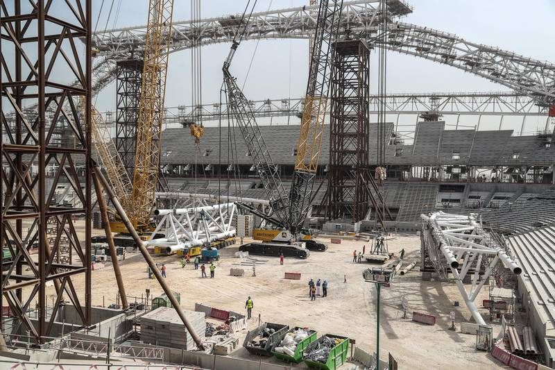 A general view taken on February 6, 2018, shows workers on the construction site at the Al-Wakrah Stadium (Al Janoub Stadium), a World Cup venue designed by celebrated Iraqi-British architect Zaha Hadid, some 15 kilometres on the outskirts of the Qatari capital Doha. - The 40,000 capacity, $575 million (465 million euros) Al-Wakrah Stadium is expected to be one of two further 2022 venues completed this year. (Photo by KARIM JAAFAR / AFP) / RESTRICTED TO EDITORIAL USE - MANDATORY MENTION OF THE ARTIST UPON PUBLICATION - TO ILLUSTRATE THE EVENT AS SPECIFIED IN THE CAPTION