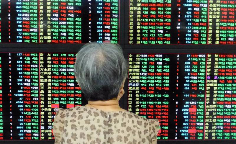 epa06772910 An investor watches a monitor at a stock exchange in Taipei, Taiwan, 30 May 2018. On 30 May, Asian stocks tumbled following large overnight loss on Wall Street due to political uncertainty in Italy, and the US will impose a 25 percent tariff on Chinese high-tech goods. The TAIEX index fell 142.95 points, or 1.3 percent, to close at 10,821.17 points.  EPA/DAVID CHANG