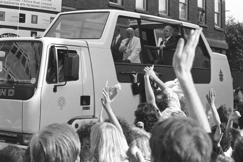 Pope John Paul II arriving at Liverpool Anglican Church, England in his Popemobile on May 30, 1982. (AP Photo/Dave Caulkin)