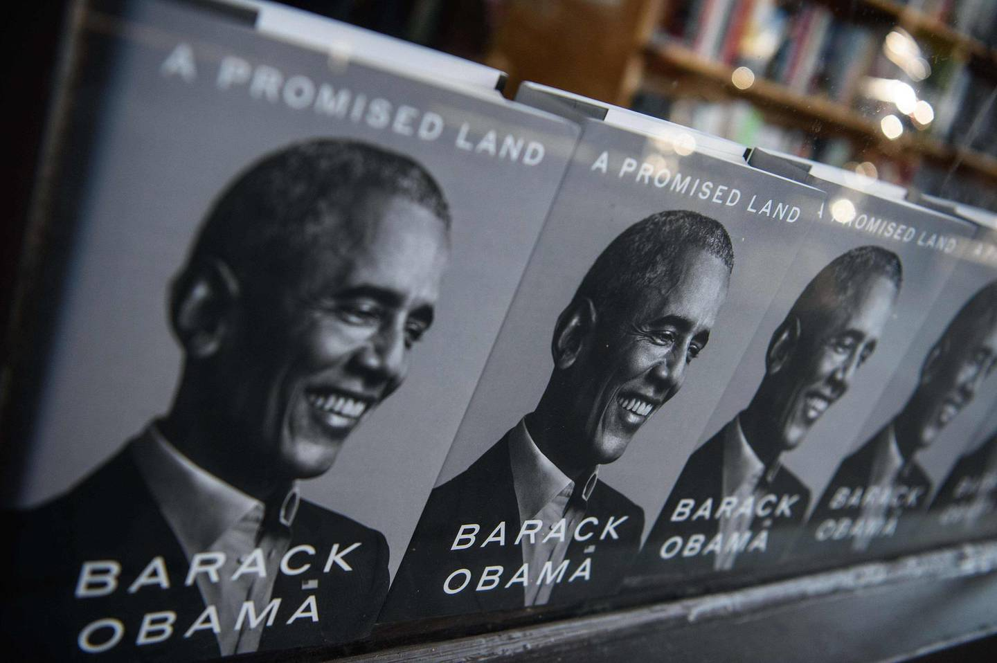 """Former US President Barack Obama's new book """"A Promised Land"""" is seen in a bookstore in Washington, DC, on November 17, 2020. Former US president Barack Obama writes in a new memoir that he is still torn by his choices in the Arab Spring, acknowledging he was inconsistent in which leaders to nudge out of power. / AFP / NICHOLAS KAMM"""