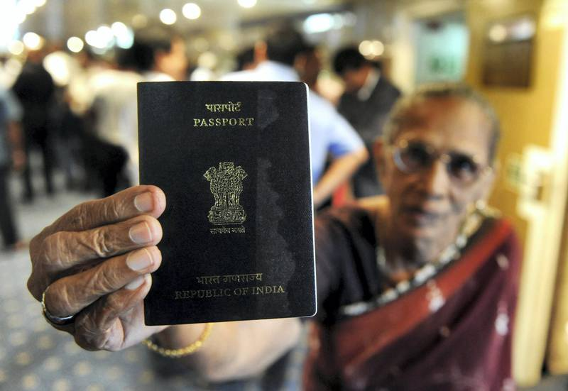 An Indian passenger holds up her passport on the Scotia Prince passenger ferry after its arrival from the Indian port of Tuticorin, in Colombo on June 14, 2011.   A passenger ferry began operations between India and Sri Lanka for the first time in 28 years after a previous service was disrupted by the island's ethnic war, officials said.  Some 201 passengers aboard the Scotia Prince arrived in Colombo on June 14, 2011 from Tuticorin on the inaugural journey of about 14 hours across the Palk Straits.   AFP PHOTO/Ishara S. KODIKARA / AFP PHOTO / Ishara S.KODIKARA