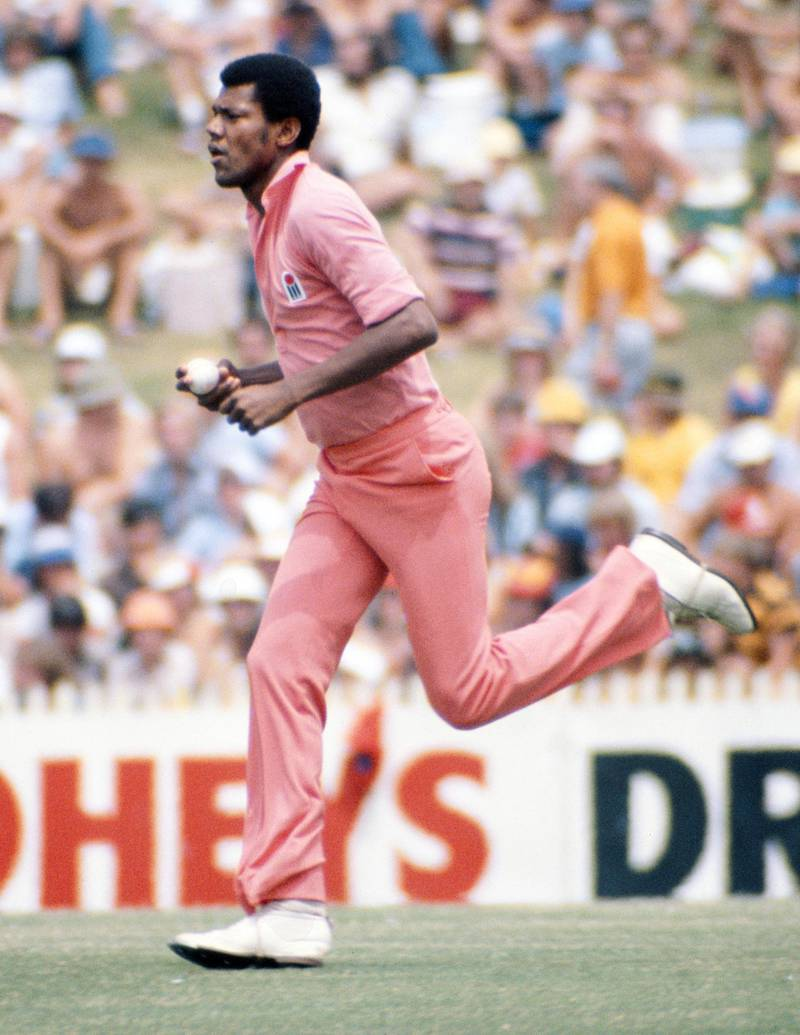 SYDNEY, AUSTRALIA - NOVEMBER 28: Colin Croft of WSC West Indies bowling in Pink clothing during the 1st One Day International of the World Series Cricket International Cup between WSC Australia and WSC West Indies, the first match in which the players wore coloured clothing, at the Sydney Cricket Ground, Sydney, Australia, 28th November 1978.  (Photo by Allsport/Getty Images/Hulton Archive)