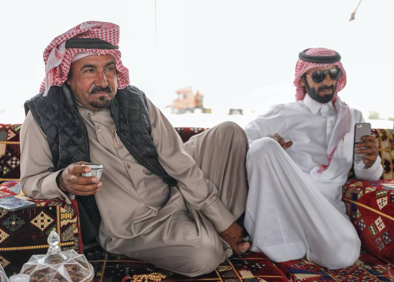 Abu Dhabi, United Arab Emirates, December 11,2019.    -- Mohammed Al Merri discusses camel pageant strategy at his family's tent in the dunes of Al Dhafra.Victor Besa/The NationalSection:  NAReporter:  Anna Zacharias