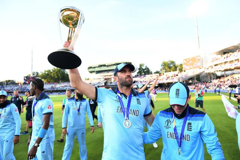 LONDON, ENGLAND - JULY 14: Liam Plunkett and Eoin Morgan of England celebrate with the trophy after winning the Final of the ICC Cricket World Cup 2019 between New Zealand and England at Lord's Cricket Ground on July 14, 2019 in London, England. (Photo by Gareth Copley-ICC/ICC via Getty Images)