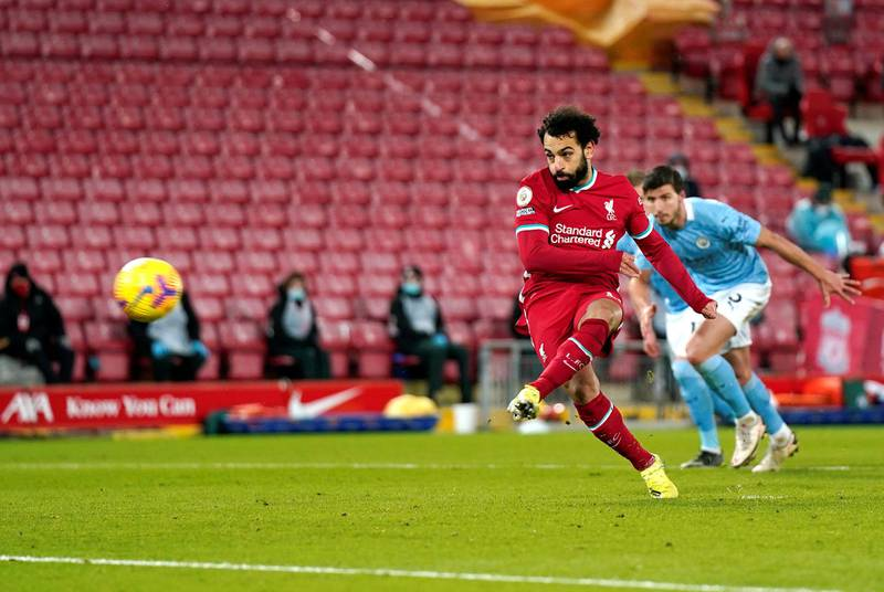 LIVERPOOL, ENGLAND - FEBRUARY 07: Mohamed Salah of Liverpool scores their side's first goal from the penalty spot during the Premier League match between Liverpool and Manchester City at Anfield on February 07, 2021 in Liverpool, England. Sporting stadiums around the UK remain under strict restrictions due to the Coronavirus Pandemic as Government social distancing laws prohibit fans inside venues resulting in games being played behind closed doors. (Photo by Tim Keeton - Pool/Getty Images)