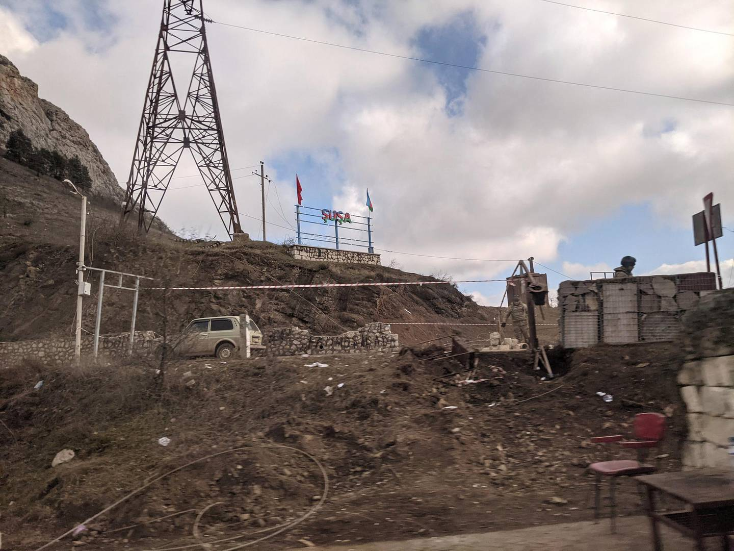 The Azerbaijani 'SHUSHA' sign flanked by Turkish and Azerbaijani flags at the entrance to Shusha just outside Stepanakert. Neil Hauer for The National