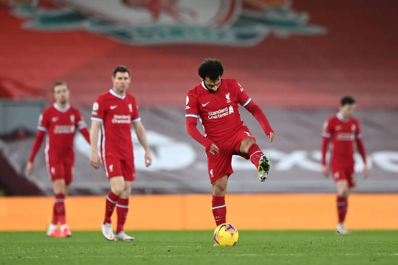 LIVERPOOL, ENGLAND - FEBRUARY 07: Mohamed Salah of Liverpool looks dejected after Manchester City's third goal scored by Raheem Sterling (Not pictured) during the Premier League match between Liverpool and Manchester City at Anfield on February 07, 2021 in Liverpool, England. Sporting stadiums around the UK remain under strict restrictions due to the Coronavirus Pandemic as Government social distancing laws prohibit fans inside venues resulting in games being played behind closed doors. (Photo by Laurence Griffiths/Getty Images)