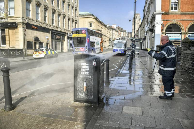 Workers from the Bristol City Centre Business Improvement District (BID) cleaning high contact public areas around Park Street and College Green, Bristol, using hot water with disinfectant and a high pressure hose, as the UK continues in lockdown to help curb the spread of the coronavirus. The cleaning opertaion is concentrating on surfaces that have a high level of public contact. (Photo by Ben Birchall/PA Images via Getty Images)