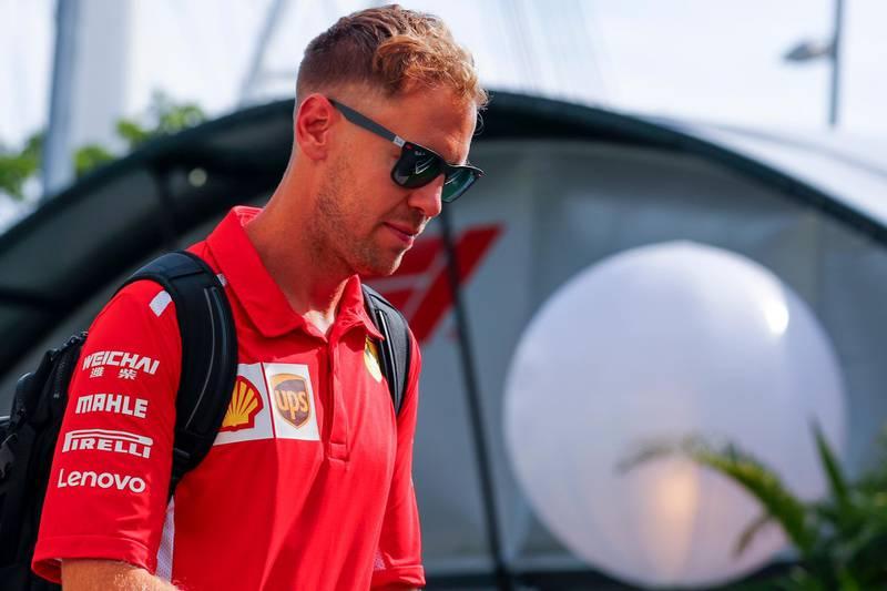 epa07017099 German Formula One driver Sebastian Vettel of Scuderia Ferrari arrives at the paddock at the Marina Bay Street Circuit in Singapore, 13 September 2018. The Singapore Formula One Grand Prix night race will take place on 16 September 2018.  EPA/DIEGO AZUBEL