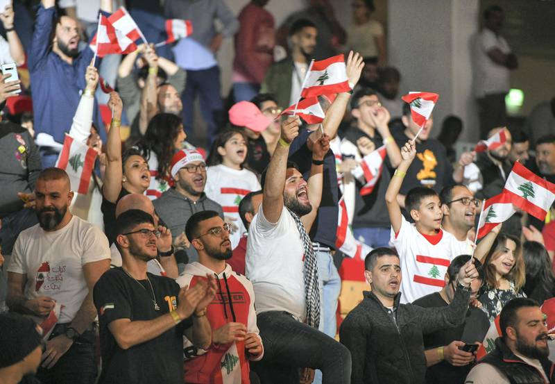 Abu Dhabi, United Arab Emirates - Lebanese fans cheer on their respective fighters at the UAE Warriors Fighting Championship in Mubadala Arena, Zayed Sports City. Khushnum Bhandari for The National