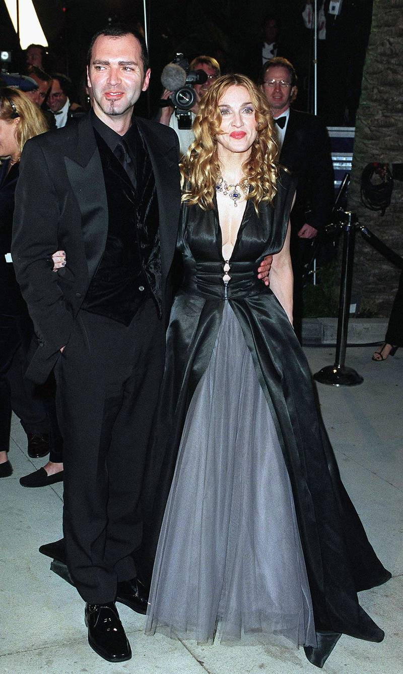 WEST HOLLYWOOD, CA - MARCH 23:  Madonna and her brother arrive at the Vanity Fair Oscar Party at Mortons March 23, 1998 in West Hollywood, California.  (Photo by John Chaple/Getty Images)