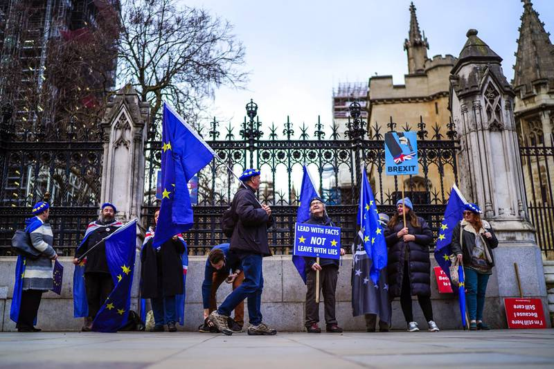 LONDON, ENGLAND - JANUARY 09: Anti-Brexit activists protest outside the Houses of Parliament on January 9, 2020 in London, England. MPs are set to vote on the Withdrawal Agreement Bill that codifies Boris Johnson's withdrawal treaty with the EU, keeping the country on-track for a January 31 Brexit. (Photo by Peter Summers/Getty Images)
