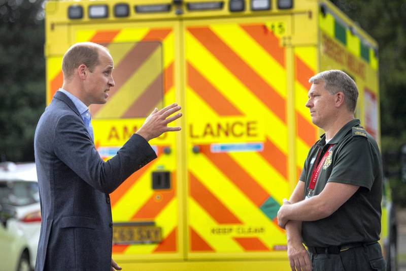 KING'S LYNN, ENGLAND - JUNE 16: Prince William, Duke of Cambridge meets paramedic staff, maintaining social distancing, from the East of England Ambulance Service Trust during a visit to the Ambulance Station on June 16, 2020 in King's Lynn, England. The purpose of the visit was to thank staff from the East of England Ambulance Service Trust for their work and dedication responding to the COVID-19 outbreak. (Photo by Victoria Jones-WPA Pool/Getty Images)