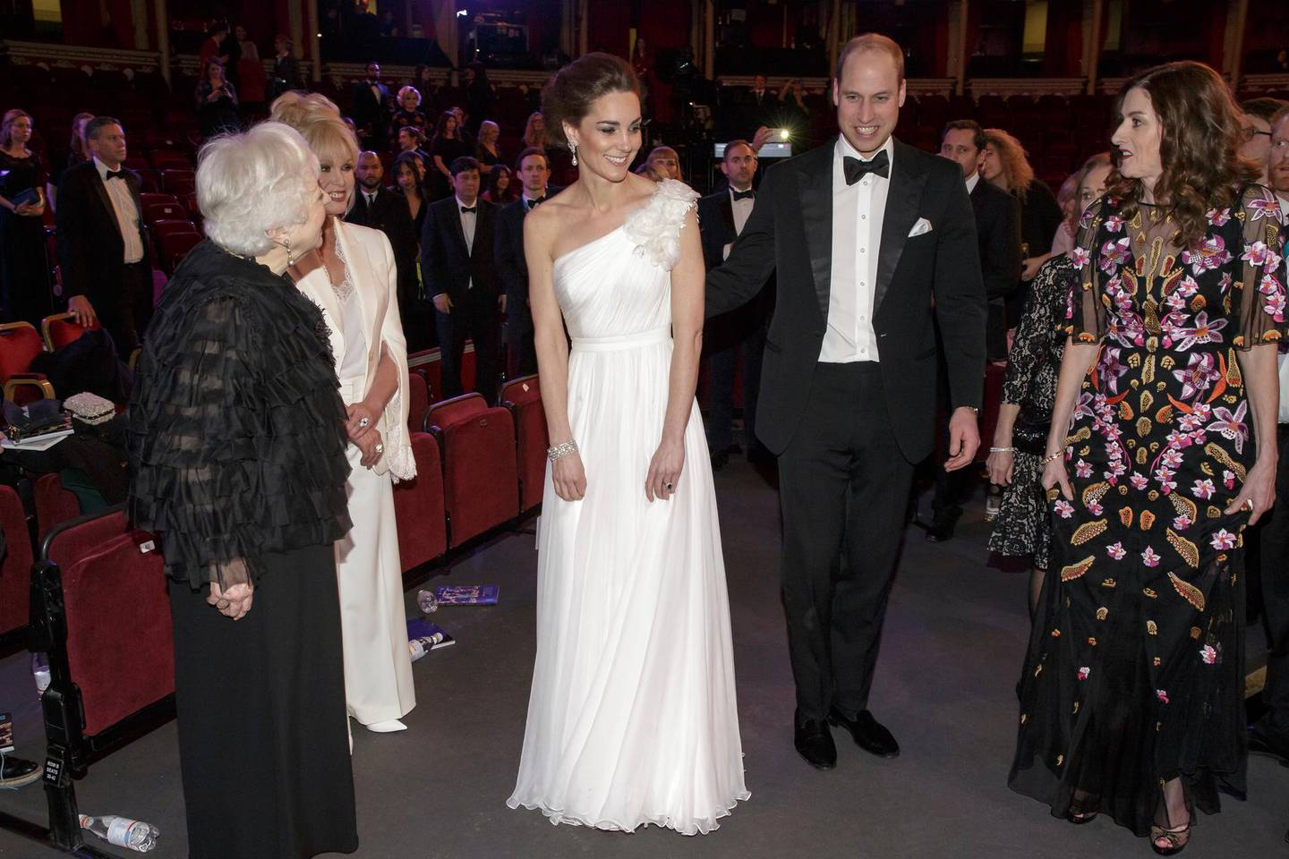 Britain's Prince William and Kate, Duchess of Cambridge with Thelma Schoonmaker, left, Joanna Lumley, 2nd left, and Amanda Berry CEO of BAFTA, right after the BAFTA 2019 Awards at The Royal Albert Hall in London, Sunday Feb. 10, 2019. (AP Photo/Tim Ireland, Pool)
