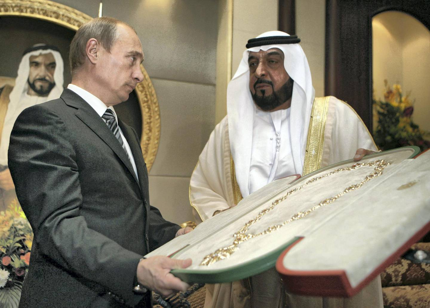 Sheikh Khalifa bin Zayed Al Nahayan (R) presents the country's highest award, the Zayed Order, to Russian President Vladimir Putin (L) at the Mushrif Palace in Abu Dhabi. Putin is accompanied on the trip by the director of arms exporter Rosoboronexport, as well as those of the airline Aeroflot and space agency Roskosmos.        RIA NOVOSTI / KREMLIN POOL / DMITRY ASTAKHOV / AFP PHOTO / POOL / DMITRY ASTAKHOV