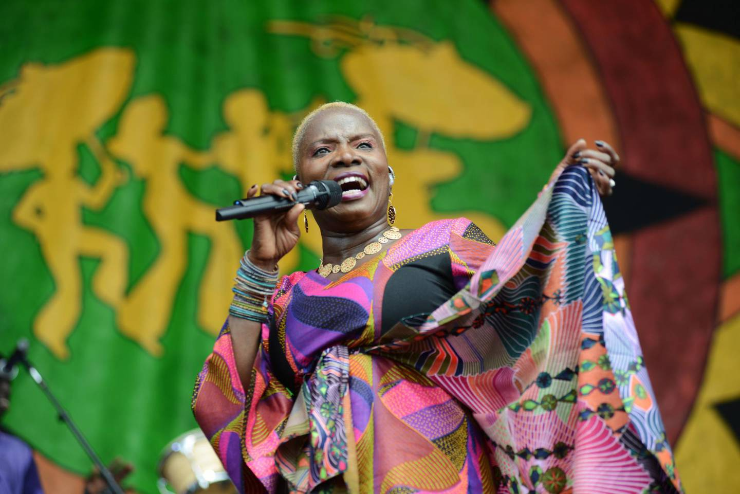 NEW ORLEANS, LA - APRIL 26:  Angelique Kidjo performs on stage at the New Orleans Jazz and Heritage Festival on April 26, 2015 in New Orleans, United States  (Photo by Leon Morris/Redferns via Getty Images)