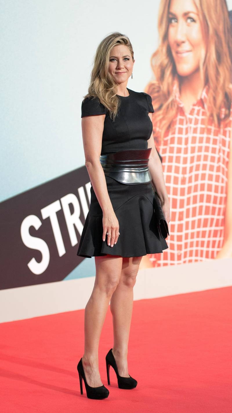 epa03826248 US actress/cast member Jennifer Aniston arrives for the premiere of We're the Millers at Cinestar in Potsdamer square in Berlin, Germany, 15 August 2013. The movie will be premiere in German theaters on 29 August.  EPA/Joerg Carstensen