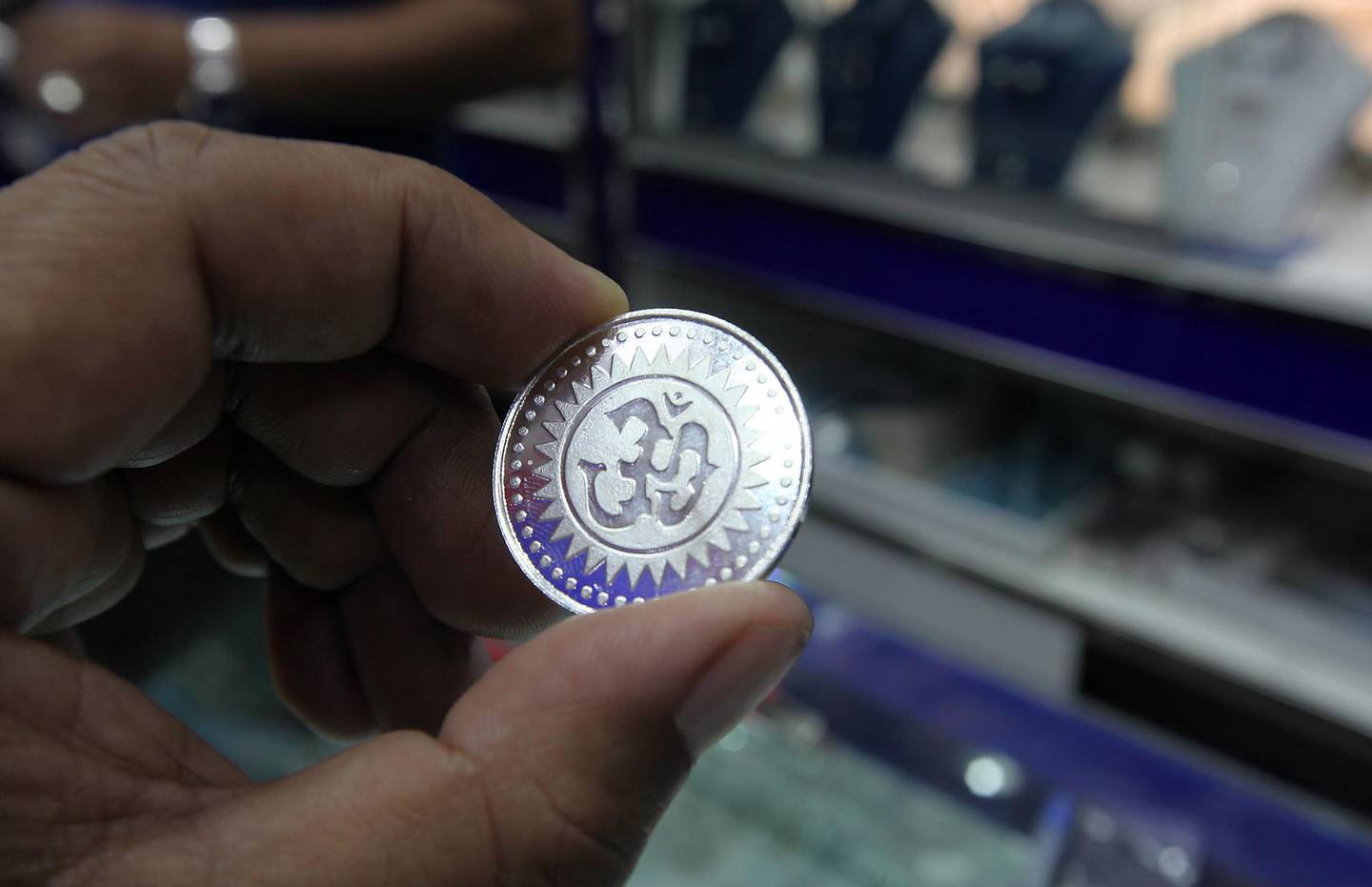 DUBAI , UNITED ARAB EMIRATES Ð Nov 11 : One of the customer buying silver coin on Dhanteras at one of the jewelry shop in Meena Bazar in Bur Dubai. Dhanteras is the first day of five days Diwali festival as celebrated in parts of North India. ( Pawan Singh / The National ) For News. Story by Preeti