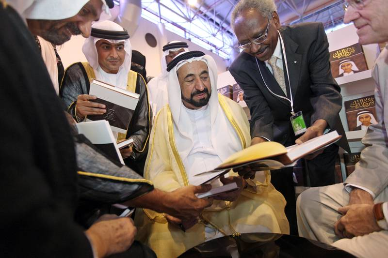 United Arab Emirates - Sharjah - October 26, 2010.  NATIONAL: H.H. Sheikh Dr Sultan Bin Mohammed Al Qasimi signs copies of his autobiography at the Sharjah International Book Fair at the Sharjah Expo Centre on Tuesday, October 26, 2010. Amy Leang/The National