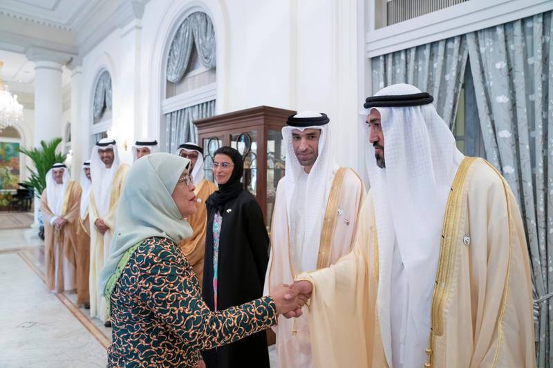 SINGAPORE, SINGAPORE - February 28, 2019: HE Halimah Yacob, President of Singapore (L), greets HE Mohamed Mubarak Al Mazrouei, Undersecretary of the Crown Prince Court of Abu Dhabi (R), prior to a meeting, at the Istana presidential palace.  ( Mohamed Al Hammadi / Ministry of Presidential Affairs ) —
