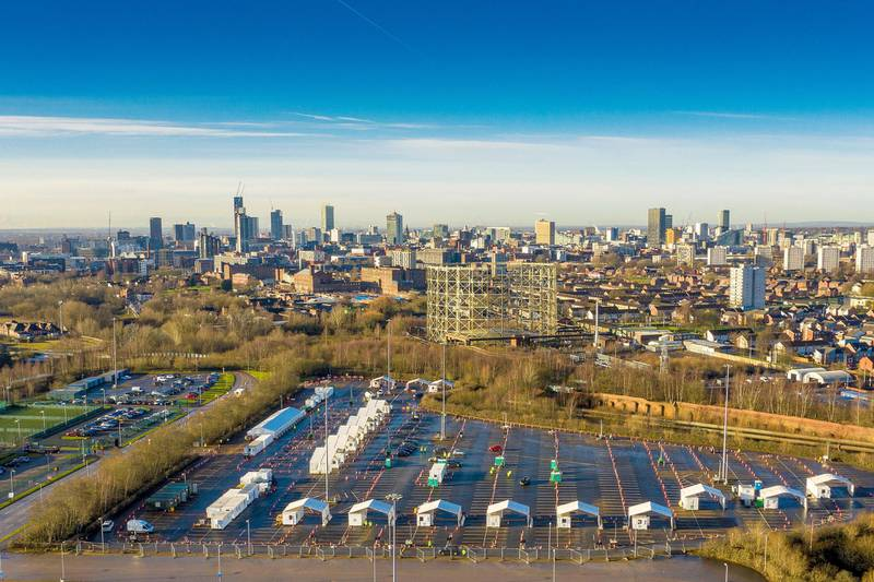MANCHESTER, ENGLAND - JANUARY 12: An aerial drone view of the Etihad tennis centre, being used as a mass vaccination centre against Covid-19 and the drive through testing centre in the car park on January 12, 2021 in Manchester, England. The location is one of several mass vaccination centres in England to open to the public this week. The UK aims to vaccinate 15 million people by mid-February. (Photo by Christopher Furlong/Getty Images)