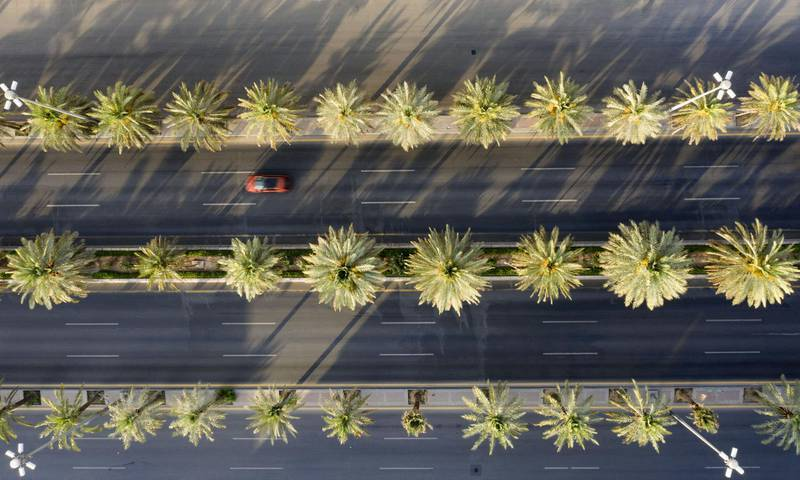An aerial view shows a section of the nearly-deserted King Fahad road due to the COVID-19 pandemic, on the first day of the Eid al-Fitr feast marking the end of the Muslim holy month of Ramadan, in the Saudi capital Riyadh, on May 24, 2020. - Saudi Arabia, home to Islam's holiest sites, began a five-day round-the-clock curfew from May 23, in a bid to stem the spread of the novel coronavirus. (Photo by FAISAL AL-NASSER / AFP)