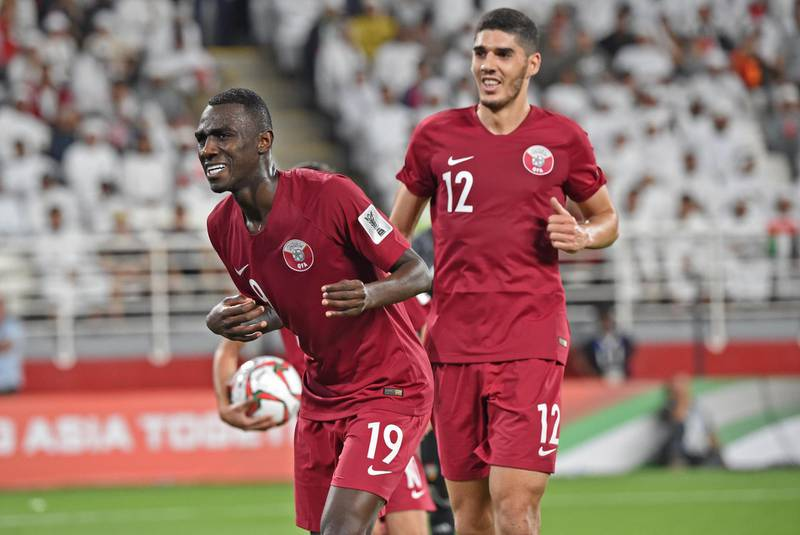 Qatar's forward Almoez Ali (L) celebrates his goal during the 2019 AFC Asian Cup semi-final football match between Qatar and UAE at the Mohammed Bin Zayed Stadium in Abu Dhabi on January 29, 2019.  / AFP / Roslan RAHMAN
