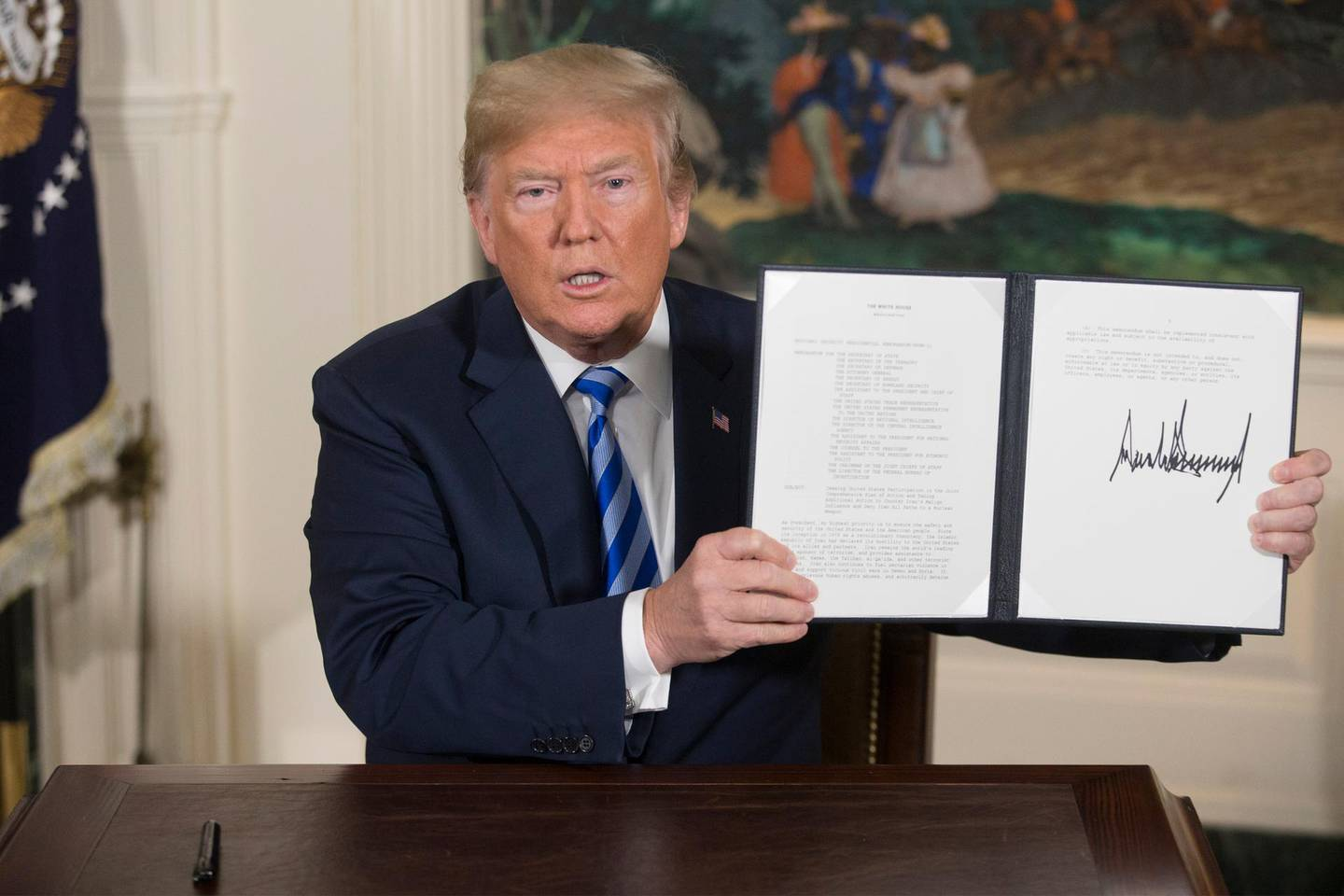 epa06720037 US President Donald J. Trump holds up a presidential memorandum he just signed in the Diplomatic Reception Room of the White House in Washington, DC, USA, 08 May 2018. Trump announces plans to pull out of Iran nuclear deal. Trump announced that he will reimpose sanctions that had been waived under the Iran nuclear deal. Five nations including the United States worked out a deal with Iran in 2015 that withdrew sanctions.  EPA/MICHAEL REYNOLDS