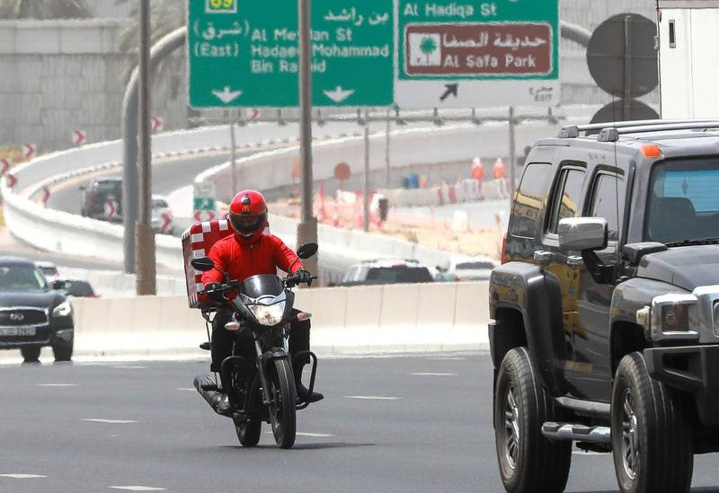Dubai, U.A.E., October 7,  2018.  Delivery drivers at Dubai. Shot  on 06-09-18. --  A McDonald���s delivery driver tries to change lanes on Sheikh Zayed Road, Dubai.Victor Besa / The NationalSection: NA