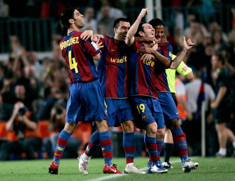 Barcelona's player Leo Messi (2nd R) celebrates with his team mate after scoring against Sevilla during their Spanish First division soccer match at Nou Camp stadium in Barcelona September 22, 2007.  REUTERS/Gustau Nacarino  (SPAIN)