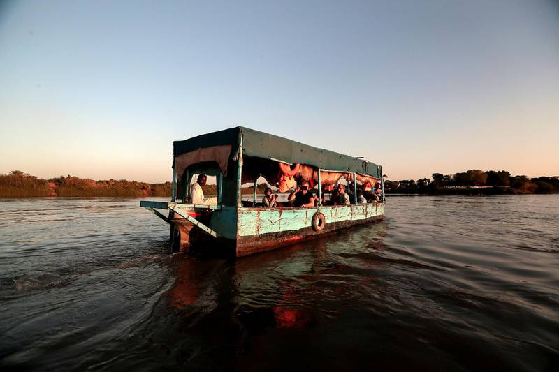 """Tourists sail across the convergence between the White Nile river and Blue Nile river in Khartoum, Sudan, February 15, 2020. REUTERS/Zohra Bensemra     SEARCH """"BENSEMRA NILE"""" FOR THIS STORY. SEARCH """"WIDER IMAGE"""" FOR ALL STORIES."""