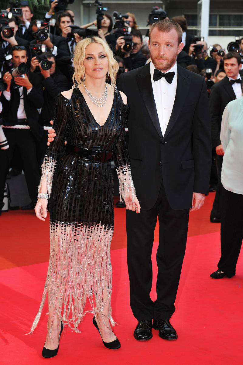 CANNES, FRANCE - MAY 21:  Madonna and husband director Guy Ritchie arrive at the  'I Am Because We Are'  Premiere at the Palais des Festivals during the 61st International Cannes Film Festival on May 21, 2008 in Cannes, France.  (Photo by Pascal Le Segretain/Getty Images)