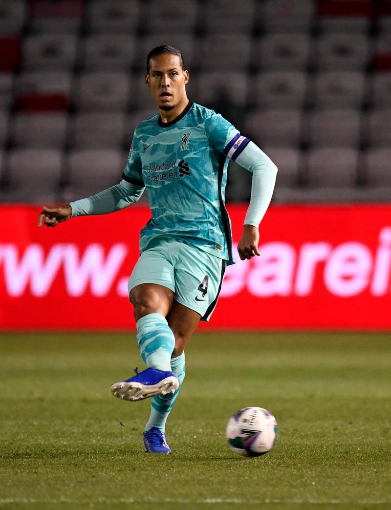 LINCOLN, ENGLAND - SEPTEMBER 24: Virgil van Dijk of Liverpool  in action during the Carabao Cup third round match between Lincoln City and Liverpool at Sincil Bank Stadium on September 24, 2020 in Lincoln, England. Football Stadiums around United Kingdom remain empty due to the Coronavirus Pandemic as Government social distancing laws prohibit fans inside venues resulting in fixtures being played behind closed doors. (Photo by Peter Powell -