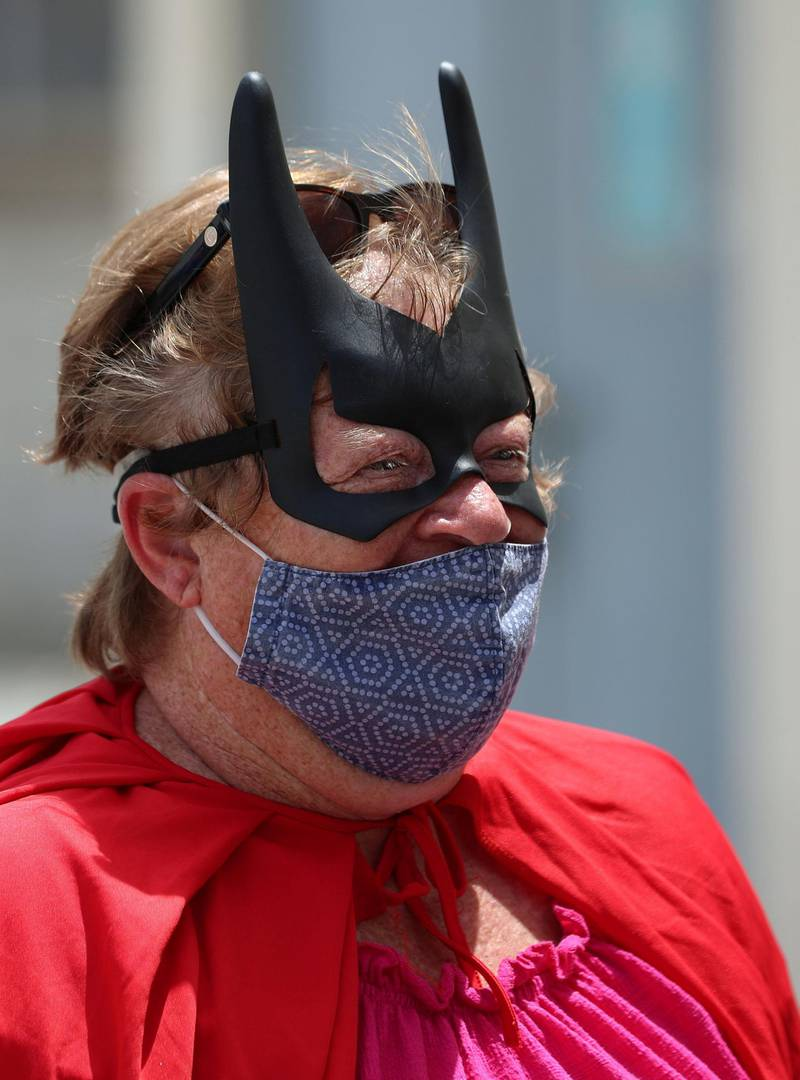 Nicky Putter. Women dressed as superheroes handed out food, water, toiletries and water bottles at a labour camp in Al Quoz, Dubai on June 25th, 2021. Chris Whiteoak / The National.  Reporter: N/A for News