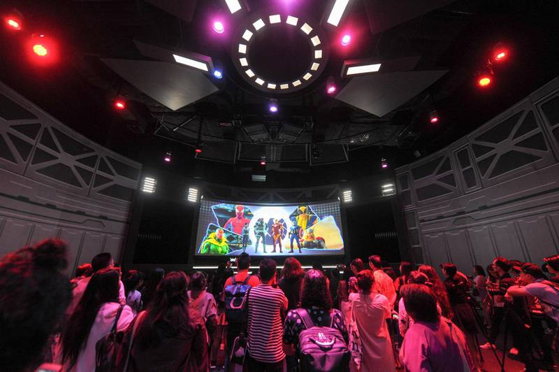 Visitors watch introduction of Marvel fictional superheroes at the Marvel Experience Thailand themed entertainment attraction in Bangkok, Thailand, 27 June 2018. The much-anticipated themed entertainment attraction The Marvel Experience Thailand will finally be open to the public from tomorrow (29 Jun). Los Angeles-based Hero Ventures and Hero Experience are teaming up to bring The Marvel Experience to Thailand, its first themed entertainment attraction to launch in South East Asia. The Marvel Experience offers fans a unique and mind-blowing family entertainment experience with the latest in state-of-the-art interactive and multimedia technology set inside a custom-made domed venue. The project is currently under construction and is expected to open in the first half of 2018, The 10,000sqm venue in the Bang Na area will allow visitors to be a part of the action through a first-of-its kind interactive adventure featuring such well-known Marvel characters as Spider-Man, Iron Man, Hulk, Thor, Black Widow, Wolverine and Captain America.  (Imaginechina via AP Images)