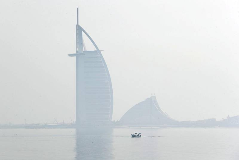 Dubai, United Arab Emirates - Reporter: N/A: Weather. Fog and mist cover the Burj Al Arab as a boat goes passed. Wednesday, April 8th, 2020. Dubai. Chris Whiteoak / The National