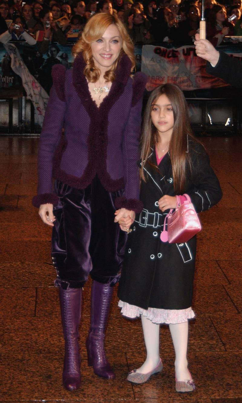"""LONDON - NOVEMBER 06:  Singer Madonna and daughter Lourdes arrive at the World Premiere of """"Harry Potter And The Goblet Of Fire"""" at the Odeon Leicester Square on November 6, 2005 in London, England.  The film is based on the fourth installment of author J.K. Rowling's novel series.  (Photo by Chris Harding/Getty Images)"""