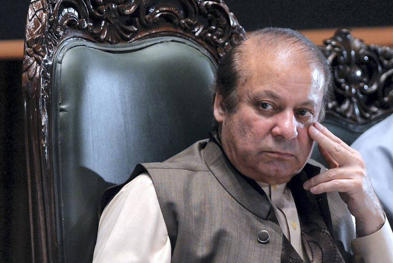 Ousted former Pakistani prime minister Nawaz Sharif looks on as he attends a seminar on 'Upholding the Sanctity of Ballot based on the Constitution, Democracy, Supremacy of Parliament and Rule of Law', in Islamabad on April 17, 2018. Pakistan's supreme court banned former prime minister Nawaz Sharif from participating in elections for life, as his embattled ruling party prepares for nationwide polls due later this year. / AFP PHOTO / AAMIR QURESHI