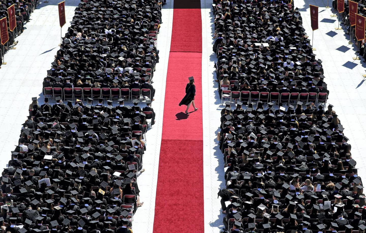 BOSTON, MA - MAY 21: A graduate crosses the red carpet during the Boston College commencement at Alumni Stadium in Boston on May 21, 2018. (Photo by David L. Ryan/The Boston Globe via Getty Images)