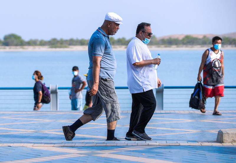 Abu Dhabi, United Arab Emirates, July 11, 2020.     Friends walk down the Corniche to get some exercise during the Coronavirus pandemic.Victor Besa  / The NationalSection:  StandaloneReporter: