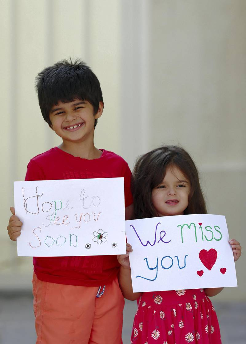 """Dubai, United Arab Emirates - Reporter: N/A. Photo Project. Missing our teachers. Kamran and Areesa Blakey, aged 6 and 3 from the UK and their teachers are Miss Corkhill and Miss Mishka at Arcadia preparatory School and Paddington Nursery. """"We miss you and hope to see you soon"""". Monday, June 8th, 2020. Dubai. Chris Whiteoak / The National"""