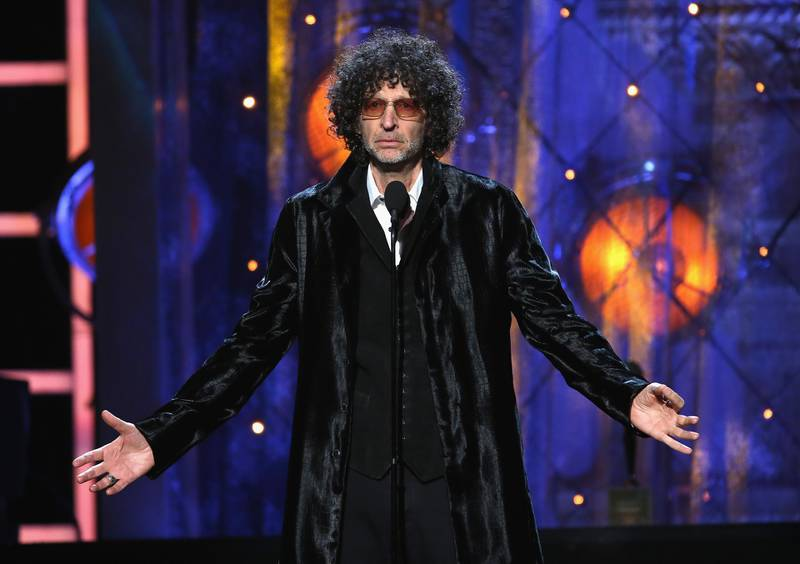 CLEVELAND, OH - APRIL 14: Howard Stern inducts Bon Jovi on stage during the 33rd Annual Rock & Roll Hall of Fame Induction Ceremony at Public Auditorium on April 14, 2018 in Cleveland, Ohio.   Kevin Kane/Getty Images For The Rock and Roll Hall of Fame/AFP