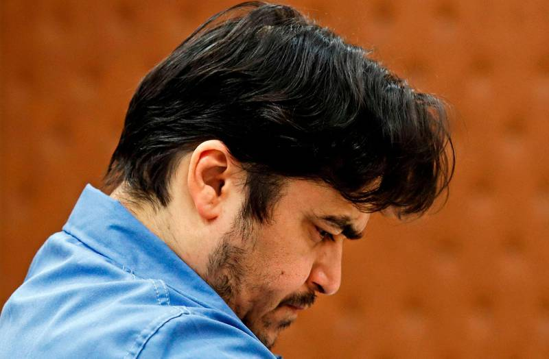 """(FILES) In this file photo taken on June 30, 2020, Ruhollah Zam, a former opposition figure who had lived in exile in France and had been implicated in anti-government protests, speaks during his trial at Iran's Revolutionary Court in Tehran. Iranian state television said the """"counter-revolutionary"""" Zam was hanged in the morning of December 12, 2020, after the supreme court upheld his sentence due to """"the severity of the crimes"""" committed against the Islamic republic. / AFP / MIZAN NEWS AGENCY / ALI SHIRBAND"""