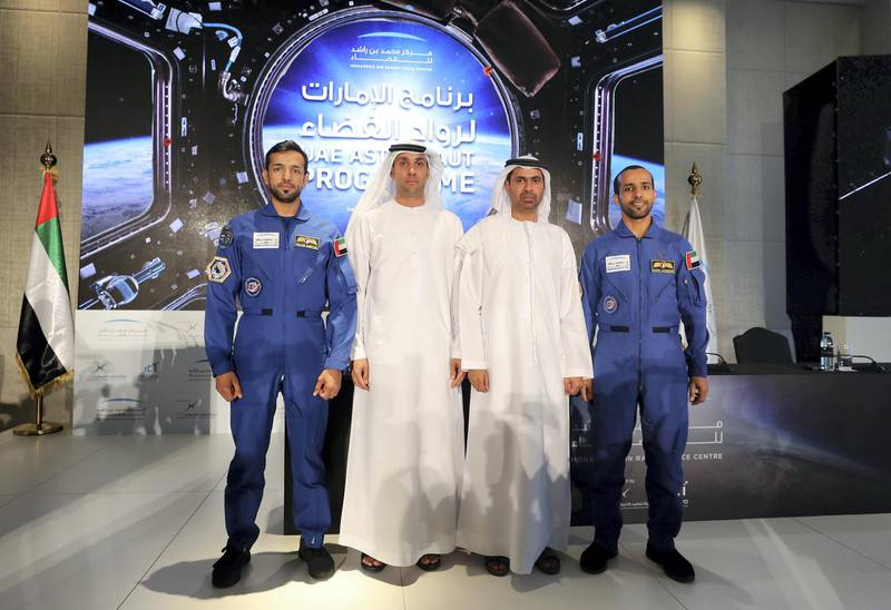 Dubai, United Arab Emirates - Reporter: Sarwat Nasir: Salem Humaid Al Marri (2nd L), assistant DG, Science and technology sector, Head of the UAE astronaut program, Yusuf Al Shaibani, Director general of MBRSC, Sultan Al Neyadi (L), back-up astronaut and the UAE's first Emirati astronaut Hazza Al Mansoori (R). Press conference by MBRSC to announce details of search for next UAE astronaut. Tuesday, 3rd of March, 2020. Downtown, Dubai. Chris Whiteoak / The National