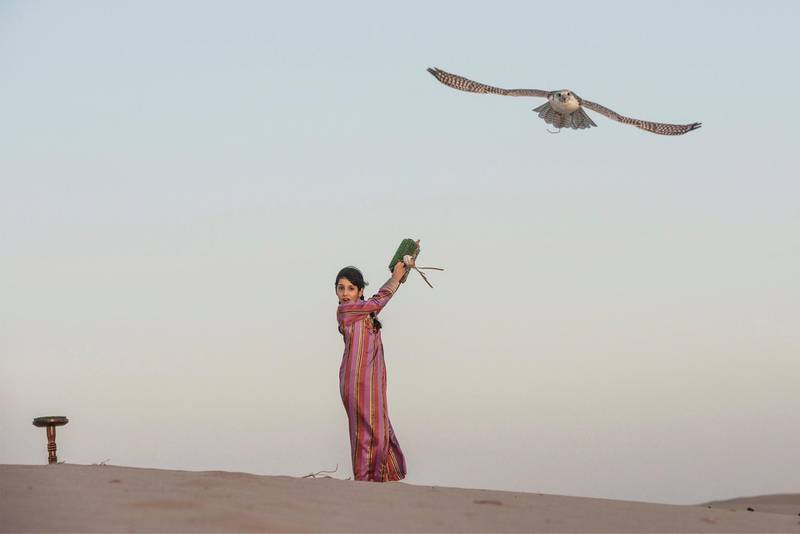 In the beautiful Abu Dhabi desert background this photograph show the young girl Osha breaking into male dominated sport and developing her skills in falconry. Vidhyaa Chandramohan for The National