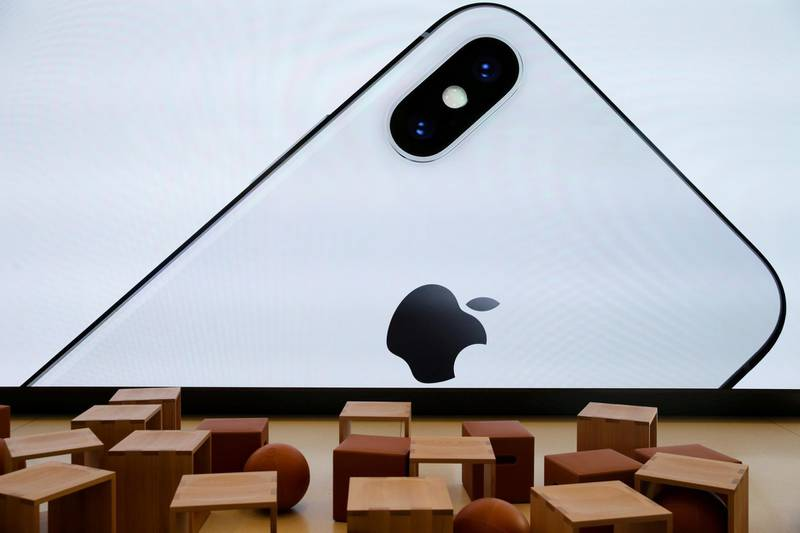 FILE PHOTO: An iPhone X is seen on a large video screen in the new Apple Visitor Center in Cupertino, California, U.S., November 17, 2017. REUTERS/Elijah Nouvelage/File Photo