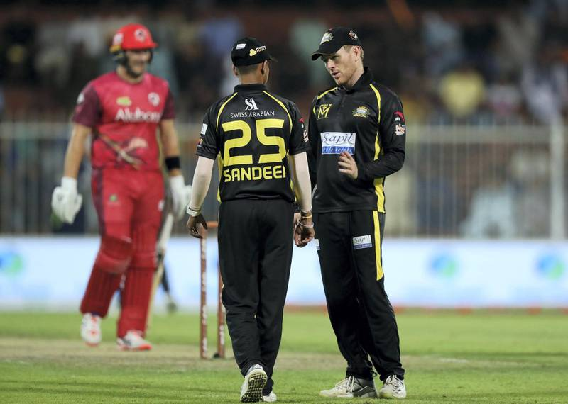 Sharjah, United Arab Emirates - November 22, 2018: Knights' Sandeep Lamichhane talks with captain Eoin Morgan during the game between Kerala Knights and Sindhis in the T10 league. Thursday the 22nd of November 2018 at Sharjah cricket stadium, Sharjah. Chris Whiteoak / The National